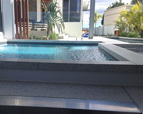 Decorative concrete pool surrounds