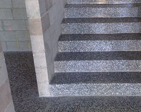 Exposed aggregate concrete stairs indoors