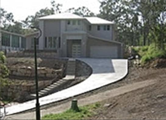 Concrete driveways and repair options mcginn concrete for Sloped driveway options