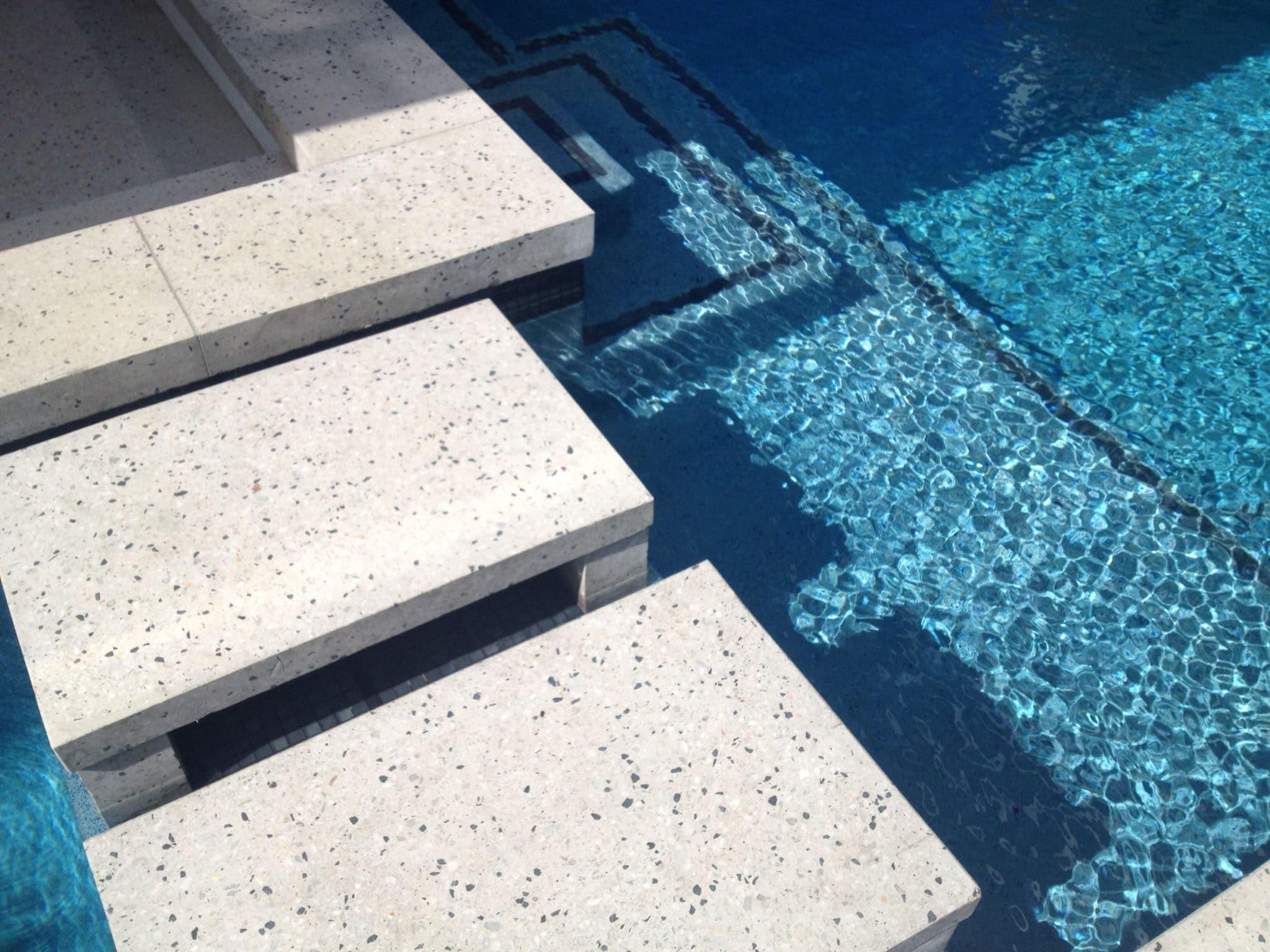White concrete steps around pool - Mcginn concrete