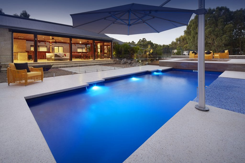 Concrete residential pool at dusk